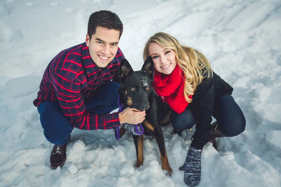 couple in snow with puppy winter engagement photo banff