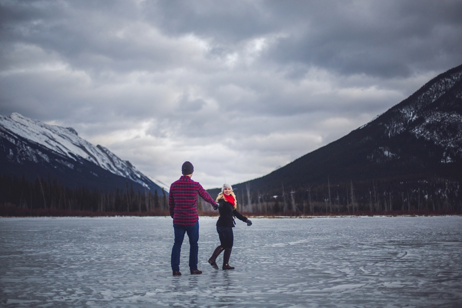 frozen vermillion lakes couple on ice winter engagement photo