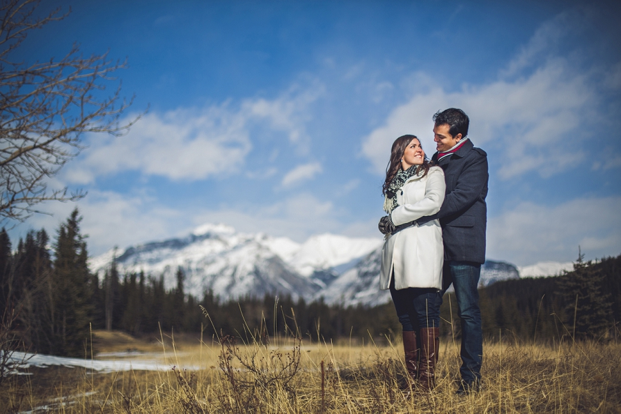 couple looking at each other mountain banff cascade ponds engagement photos
