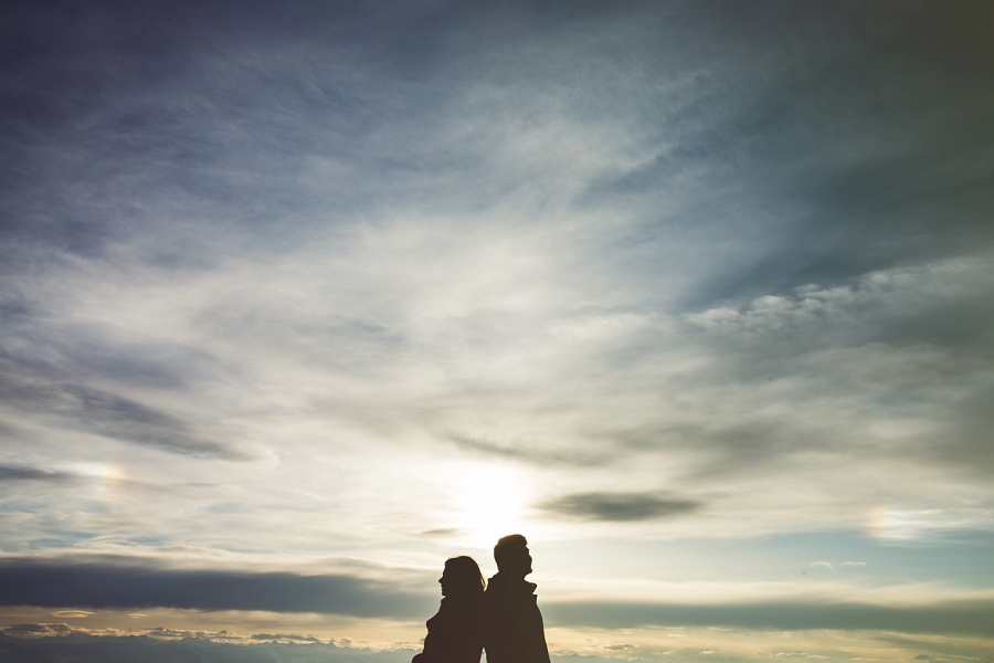 calgary engagement session couple silhouette sunset sundog