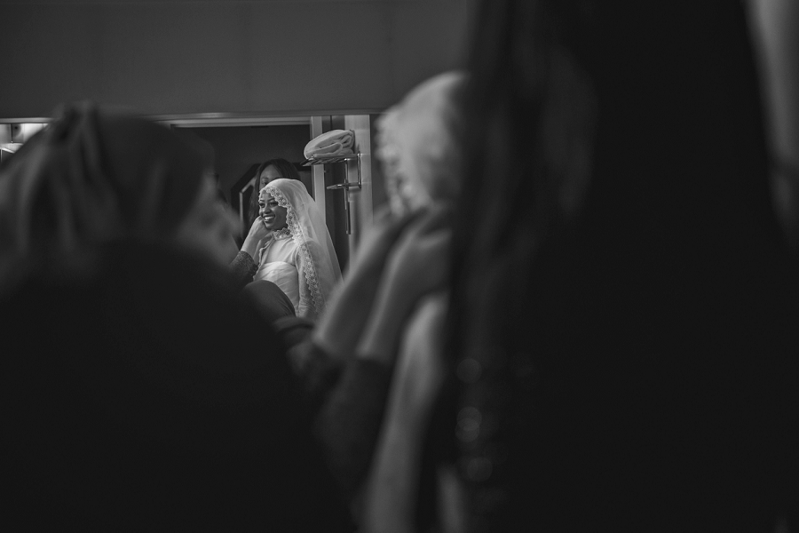 bride getting ready veil multicultural islamic wedding in calgary photographer