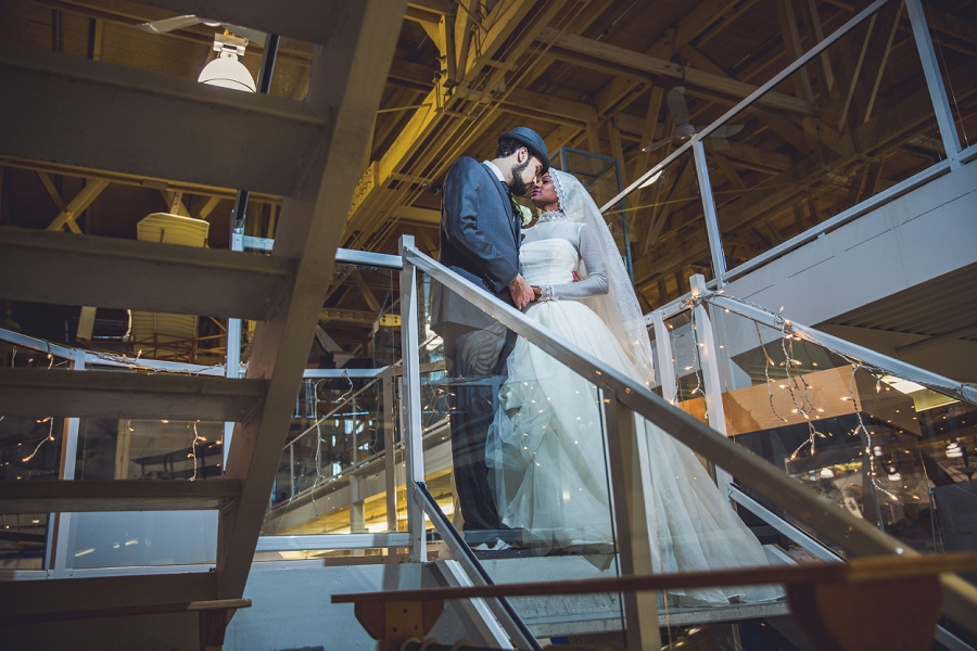 bride groom calgary aerospace museum stairs fairy lights multicultural islamic wedding in calgary photographer