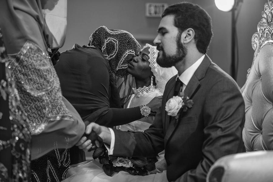 bride crying multicultural islamic wedding in calgary photographer ramada plaza hotel