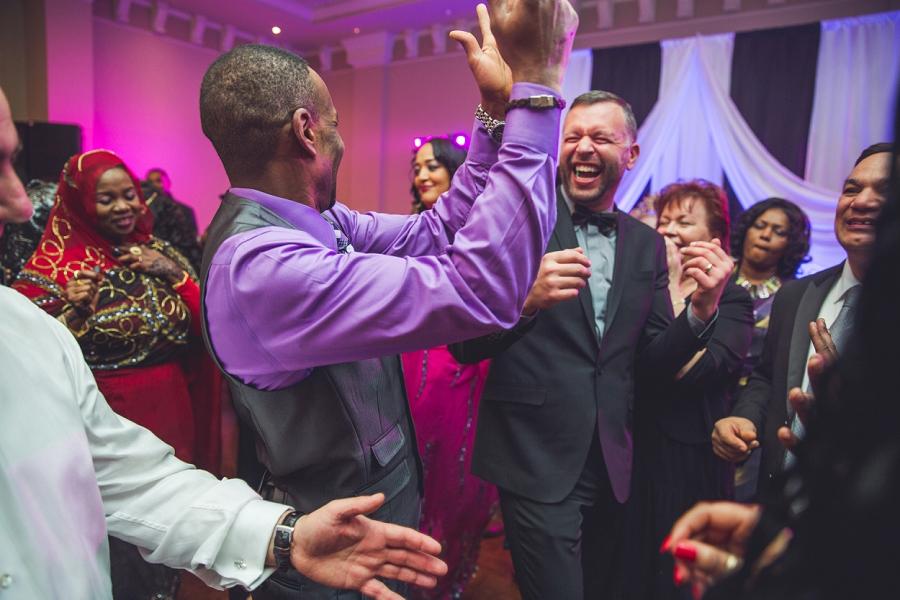wedding dance floor multicultural wedding in calgary photographer ramada plaza hotel
