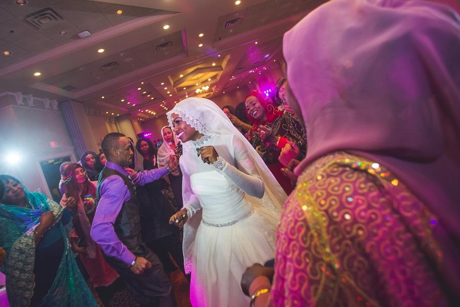 bride dancing multicultural islamic wedding in calgary photographer ramada plaza hotel