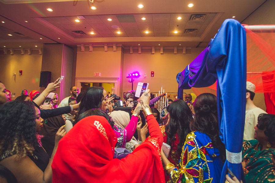 crowd multicultural wedding in calgary photographer ramada plaza hotel