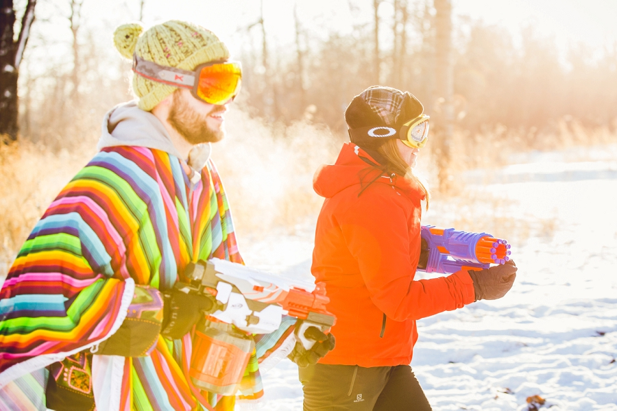 calgary engagement photos nerf gun fight sunset winter