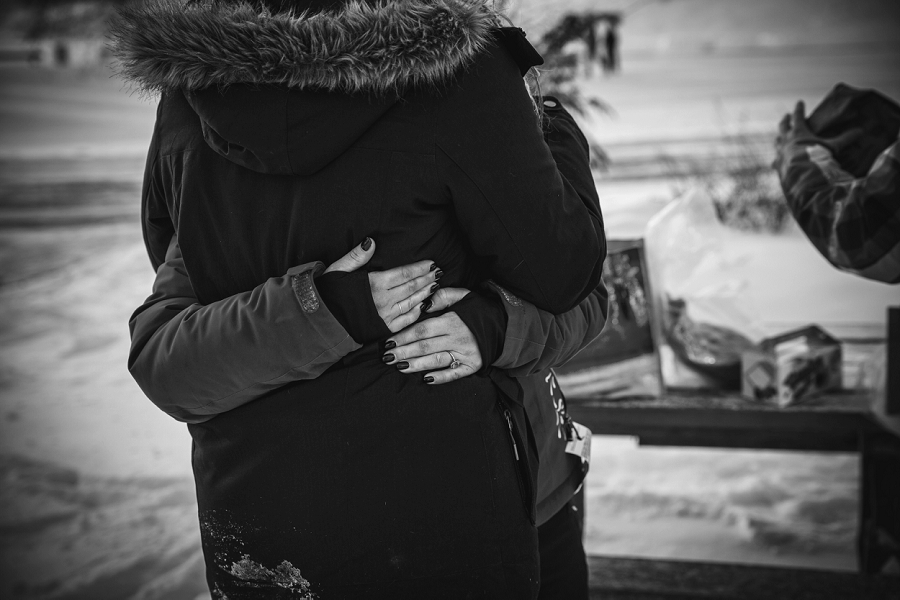 calgary winter black white hug engagement session