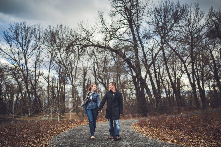 couple walking pearce estate park calgary engagement photos