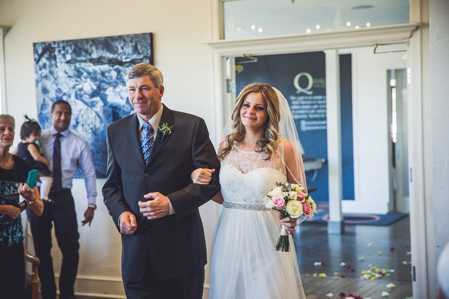 bride walking down with father q haute cuisine calgary wedding photographer