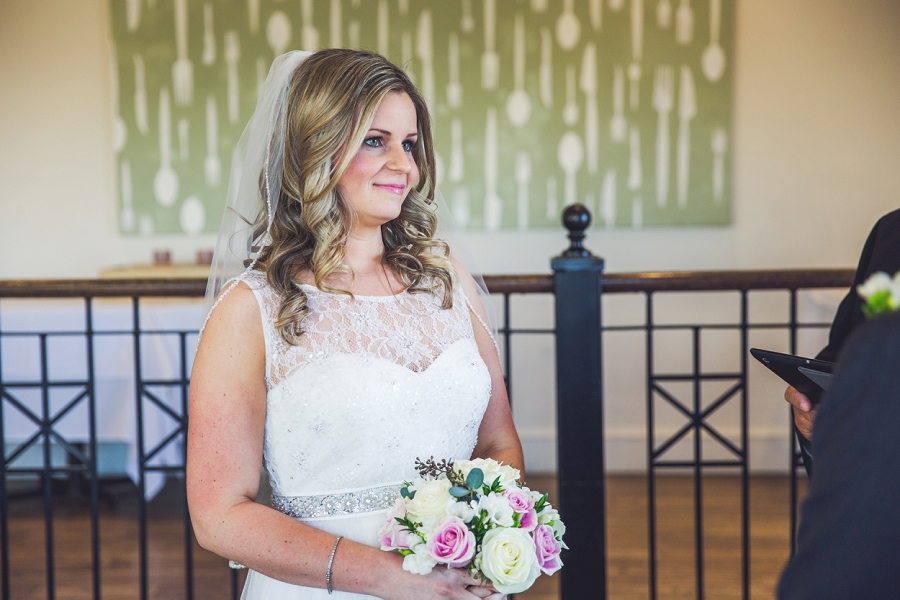 bride smiling q haute cuisine calgary wedding photographer