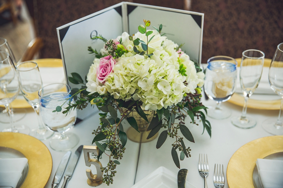 q haute cuisine calgary wedding photographer reception decor flowers center piece
