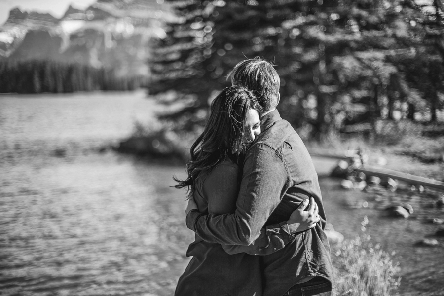 couple hugging black and white banff alberta engagement photos