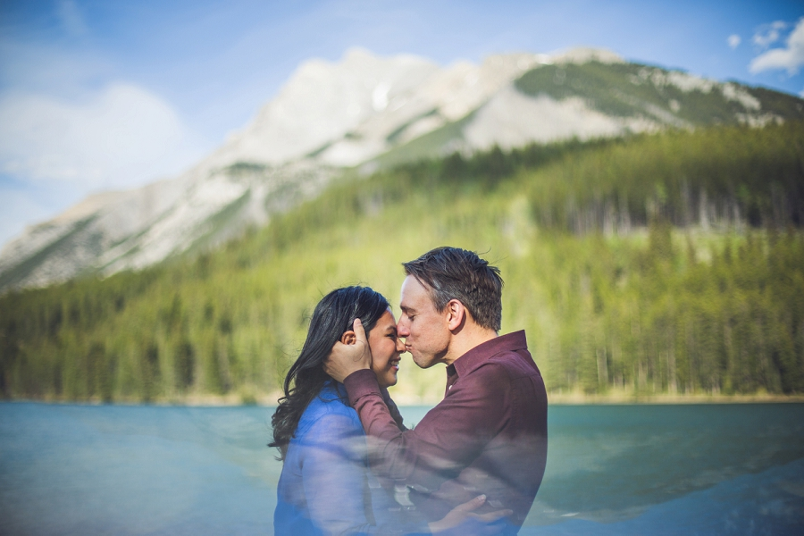 mountain groom kissing bride on nose banff engagement photos
