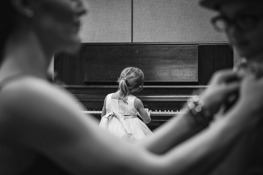little girl plays piano st. anthony's parish calgary wedding photography