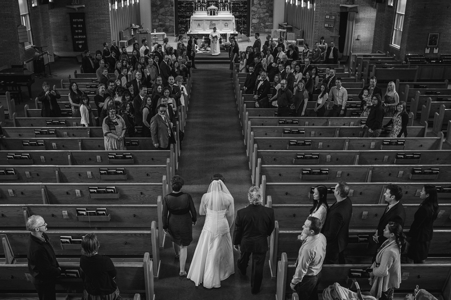 bride walks down the aisle st. anthony's parish calgary wedding photography