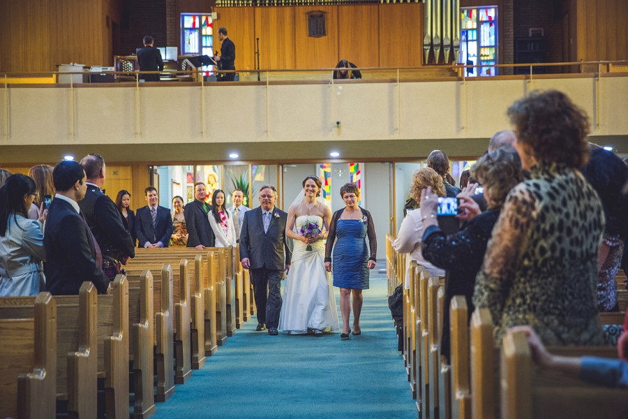 st. anthony's parish calgary wedding photography bride walking down aisle with parents