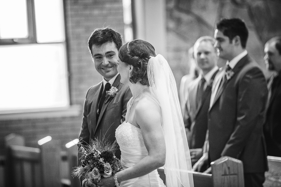 groom smiling at bride st. anthony's parish calgary wedding photography pi day