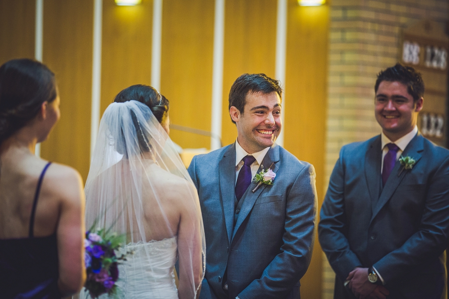 groom smiling at guests st. anthony's parish calgary wedding photography pi day