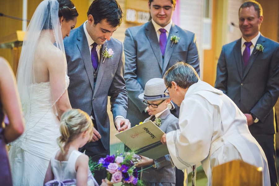 groom exchange of rings st. anthony's parish calgary wedding photography pi day