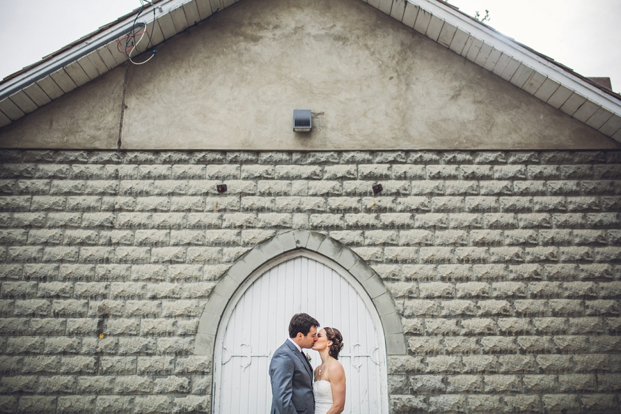reader rock gardens calgary wedding photography pi day bride groom kiss white door