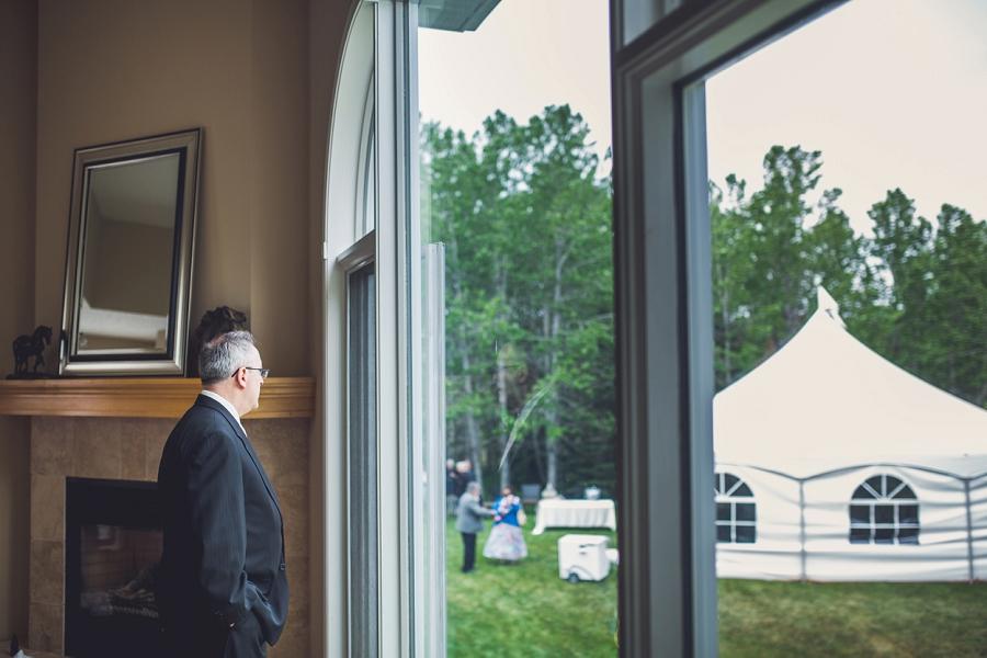 father of bride overlooking wedding tent calgary