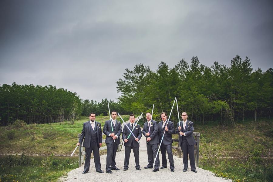 groom posing with groomsmen wedding lightsabers calgary
