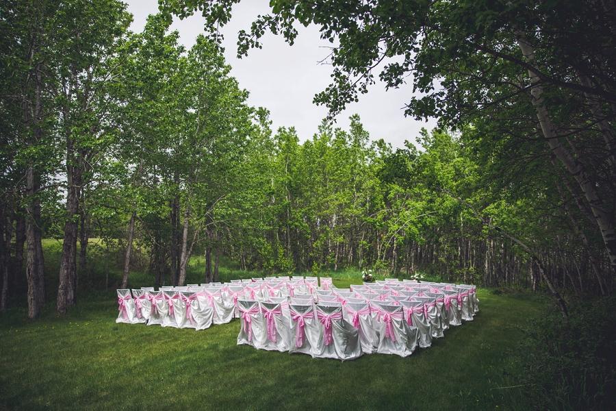 white chair decorations pink sash calgary wedding