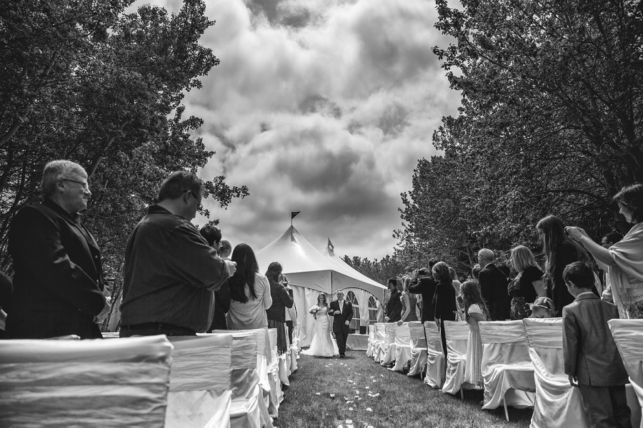 bride walking down aisle calgary backyard wedding