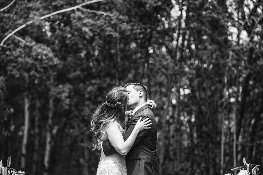 bride groom first kiss backyard wedding ceremony calgary