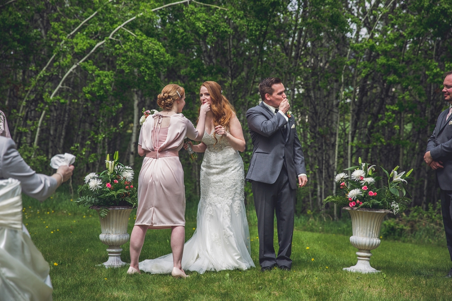 wiping lipstick after first kiss backyard wedding ceremony