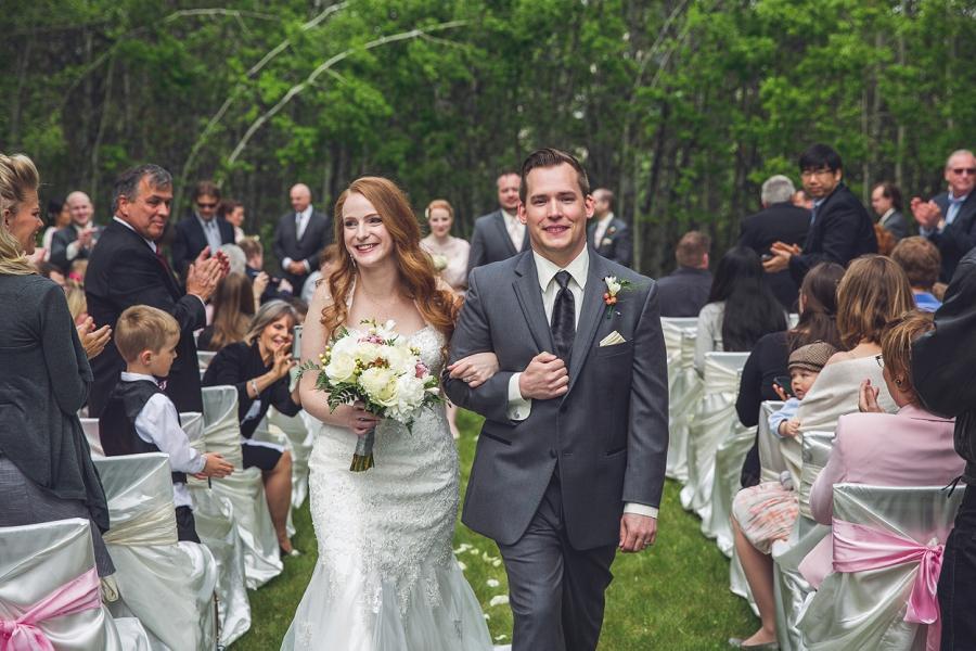 bride groom processional smiling backyard wedding ceremony