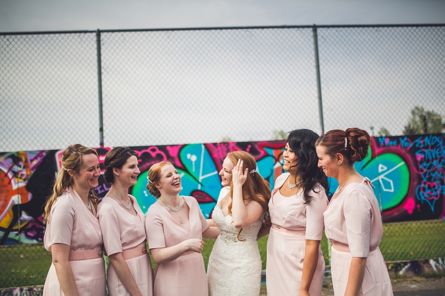 bride with bridesmaids laughing calgary wedding