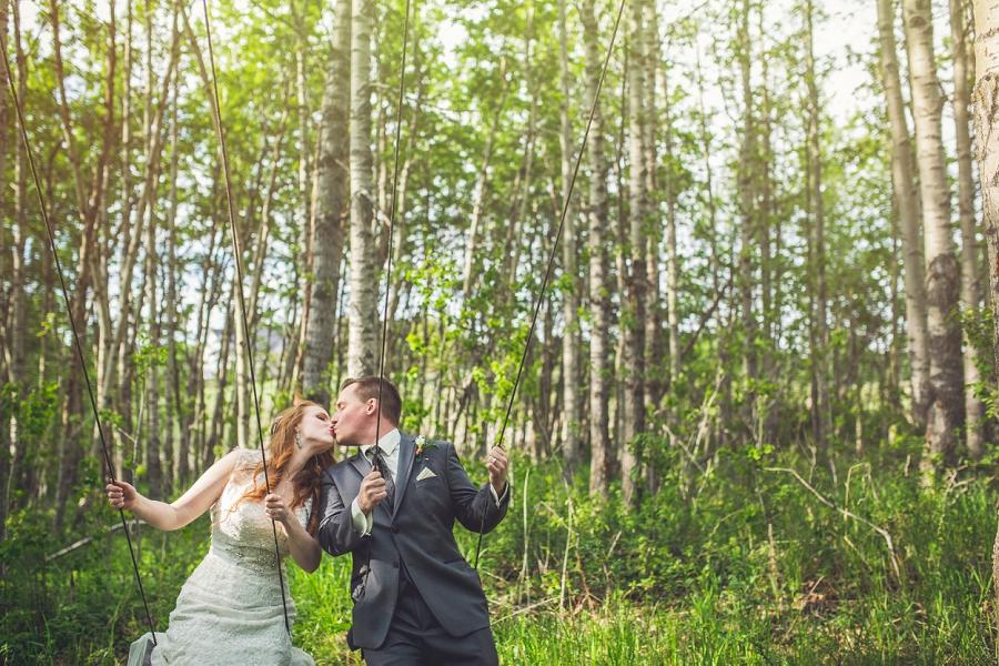 bride groom on swing set calgary wedding