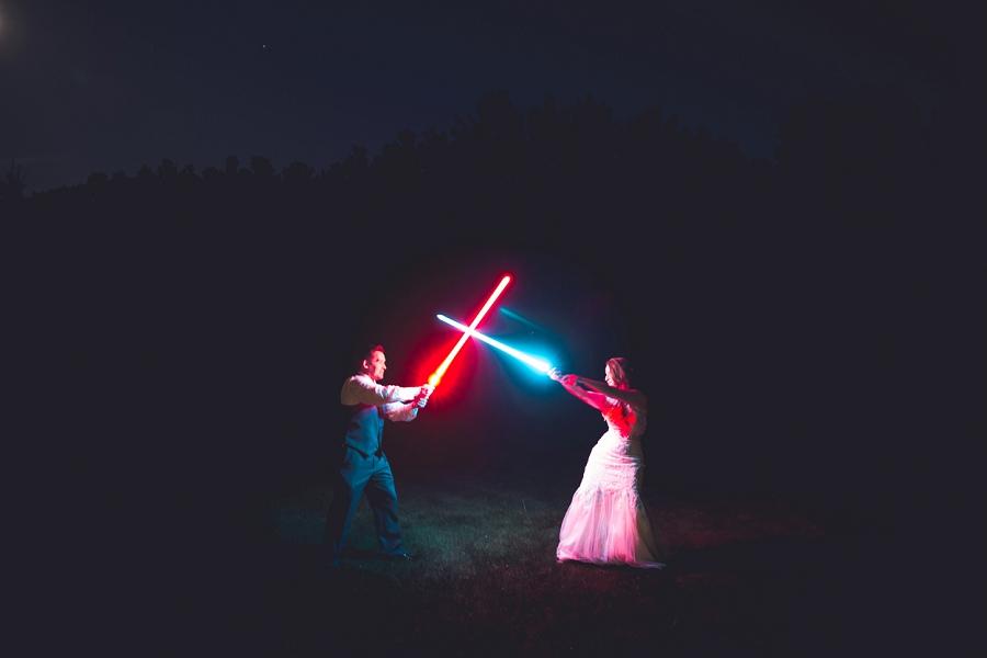 bride groom lightsaber fight calgary wedding