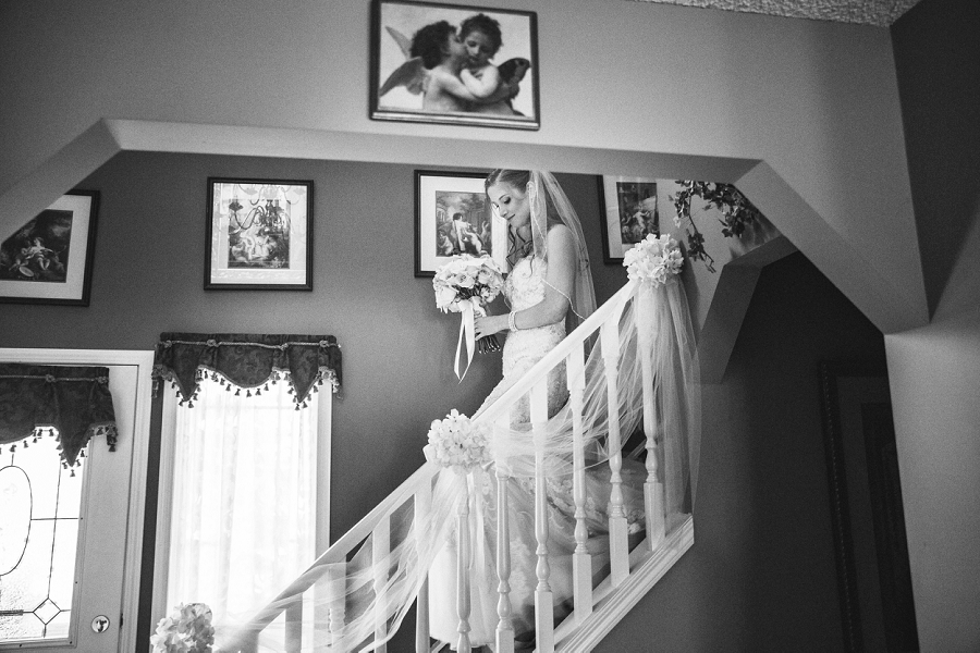 bride walks down stairs to greet family