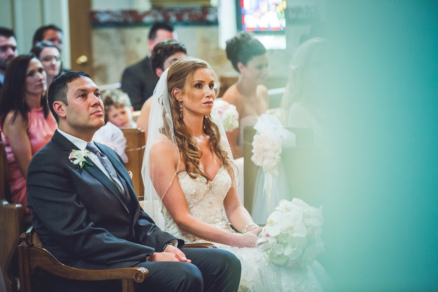bride groom sitting at ceremony sacred heart church