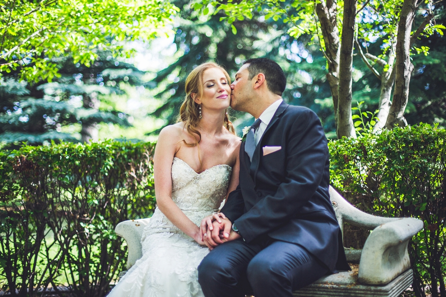 groom kisses bride gerry shaw gardens
