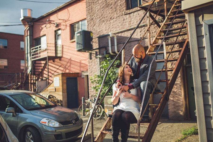 calgary inglewood engagement session couple sitting on old stairs