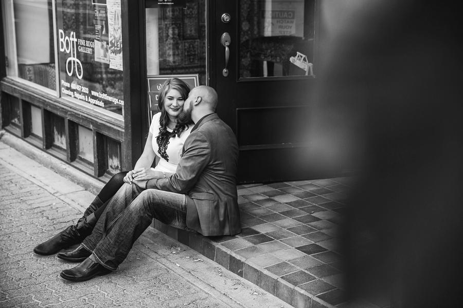 groom kisses bride calgary inglewood engagement session