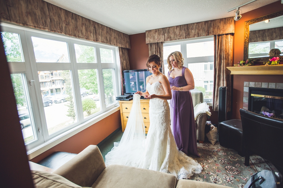 wind tower hotel canmore bride putting on wedding dress