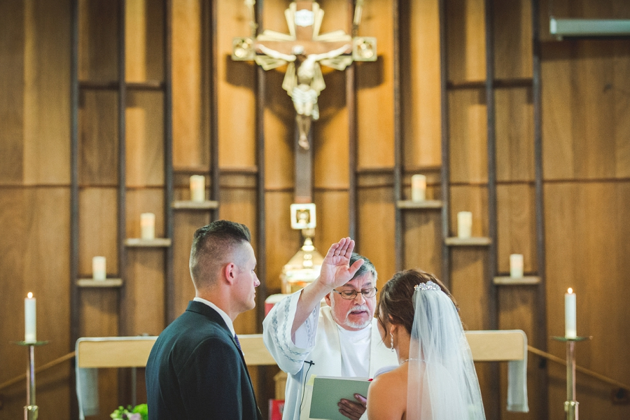 priest blessing wedding couple our lady of the rockies parish canmore