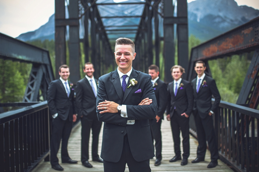 engine bridge canmore groom smiling with groomsmen
