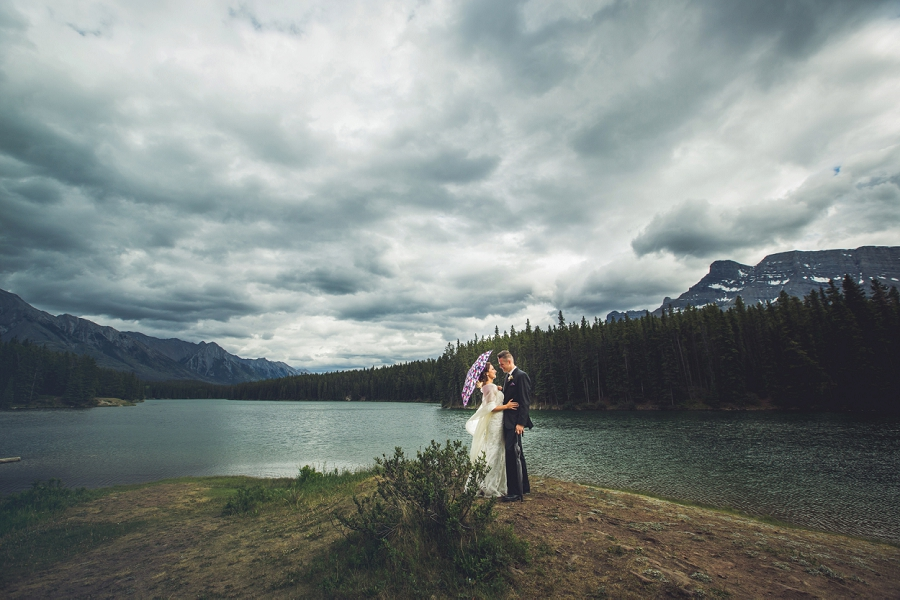 stormy clouds mountains bride and groom