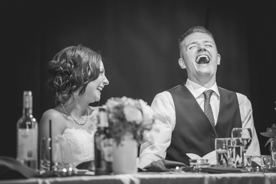 groom laughing cornerstone theatre canmore wedding