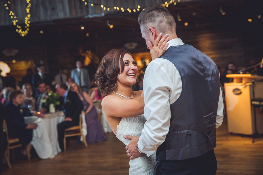 bride smiling at groom first dance cornerstone theatre canmore wedding