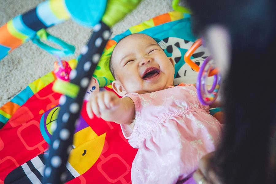 mom tickling toddler calgary family photography