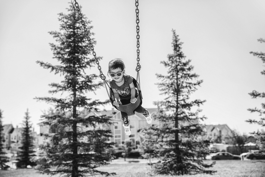 black and white child swing calgary family photography