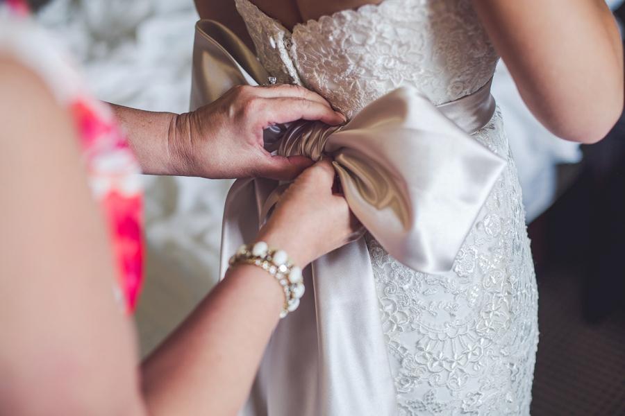 big bow wedding dress acclaim hotel calgary wedding bride getting ready