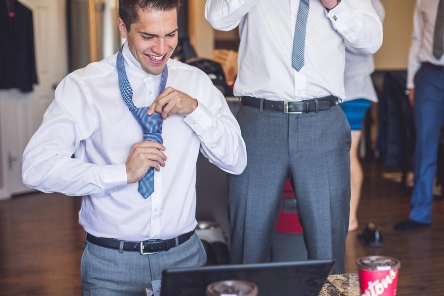 groomsmen tying a tie groom groomsmen getting ready
